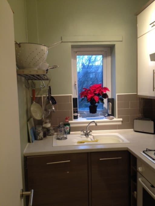 lovely kitchen fully equipped with all your needs and a wine bottle opener