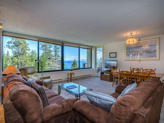 Living room with sofa, loveseat, recliner, and flat screen TV. This property is professionally managed by TurnKey Vacation Rentals.