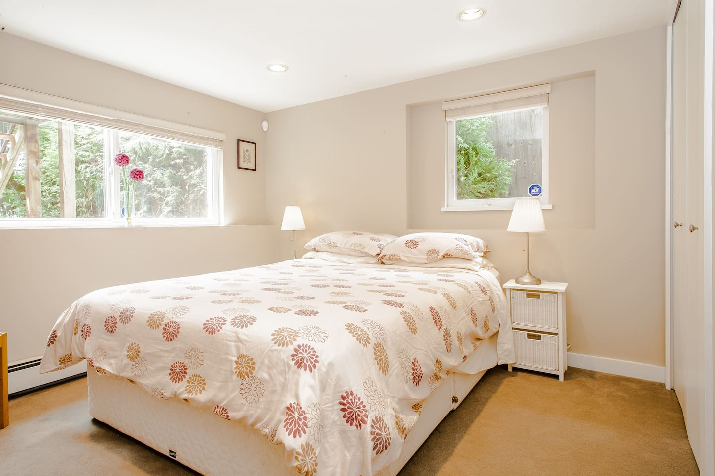 Bright attractive bedroom with comfortable queen bed