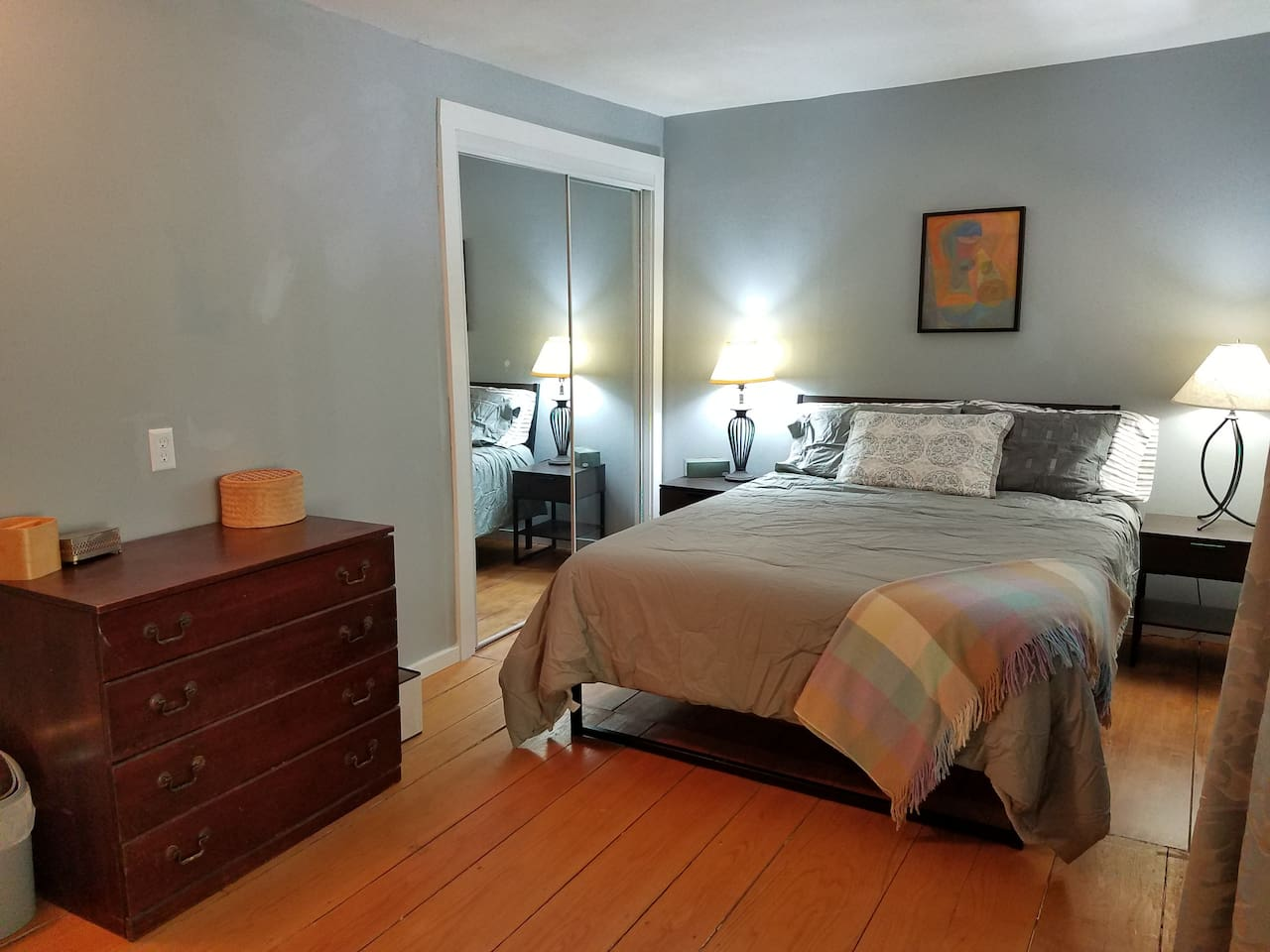 The apartment includes a spacious bedroom with a queen size Tempur-Pedic mattress.