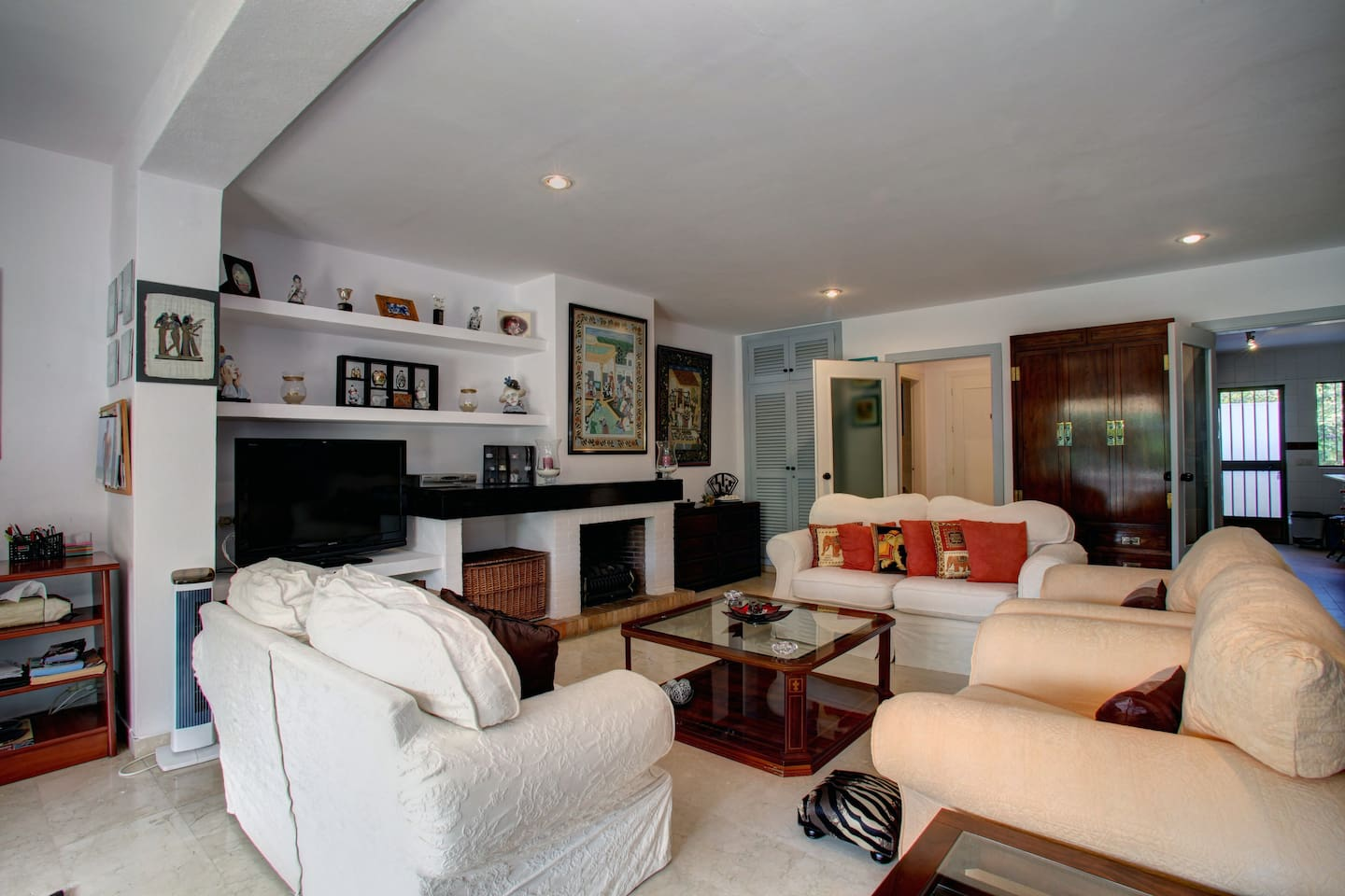 Living room with working fireplace and flat screen tv.