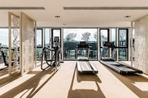 The gym on the 14th floor enjoys your workout with the view of the city.