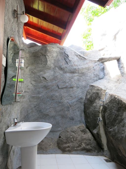 open air bathroom with hot shower