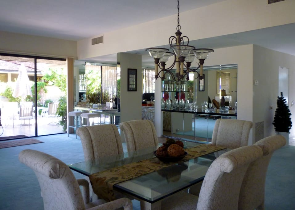 THE DINING AREA AND THE WET BAR WITH SIDE PATIO AND EATING AND GRILL AREA