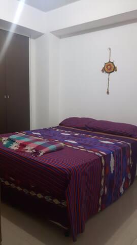 The room. You have a double beed with a new and comfortable mattress. The door can be looked from the inside.   Este es el cuarto. Tiene una cama matrimonial con un nuevo y confortable colchón.   La puerta tiene cerradura interna.