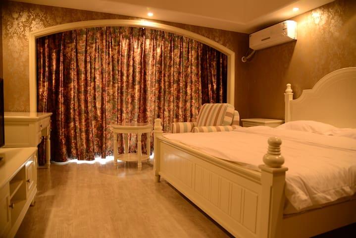 黄金海岸孤独图书馆高尔夫球场园景公寓814 - Qinhuangdao - Huoneisto