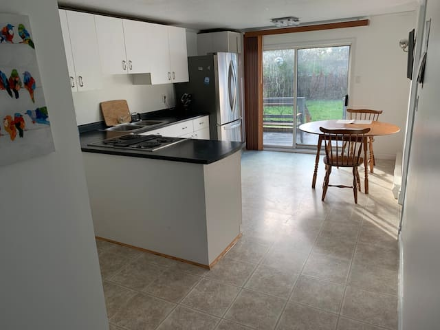 Sunny open roomy kitchen in your own home setting .