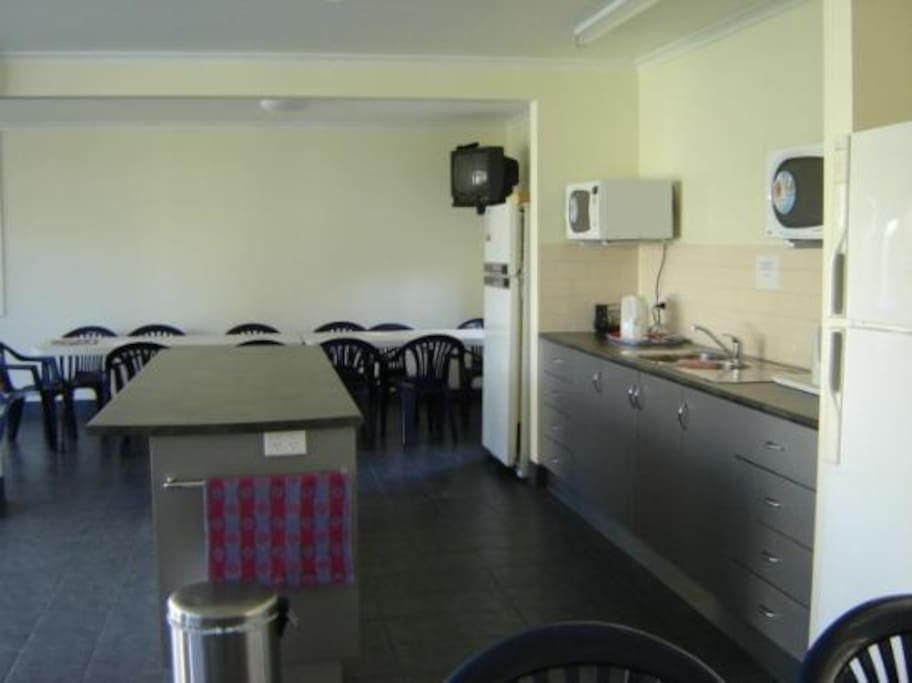 Large shared common room with cooking facilities, T.V's