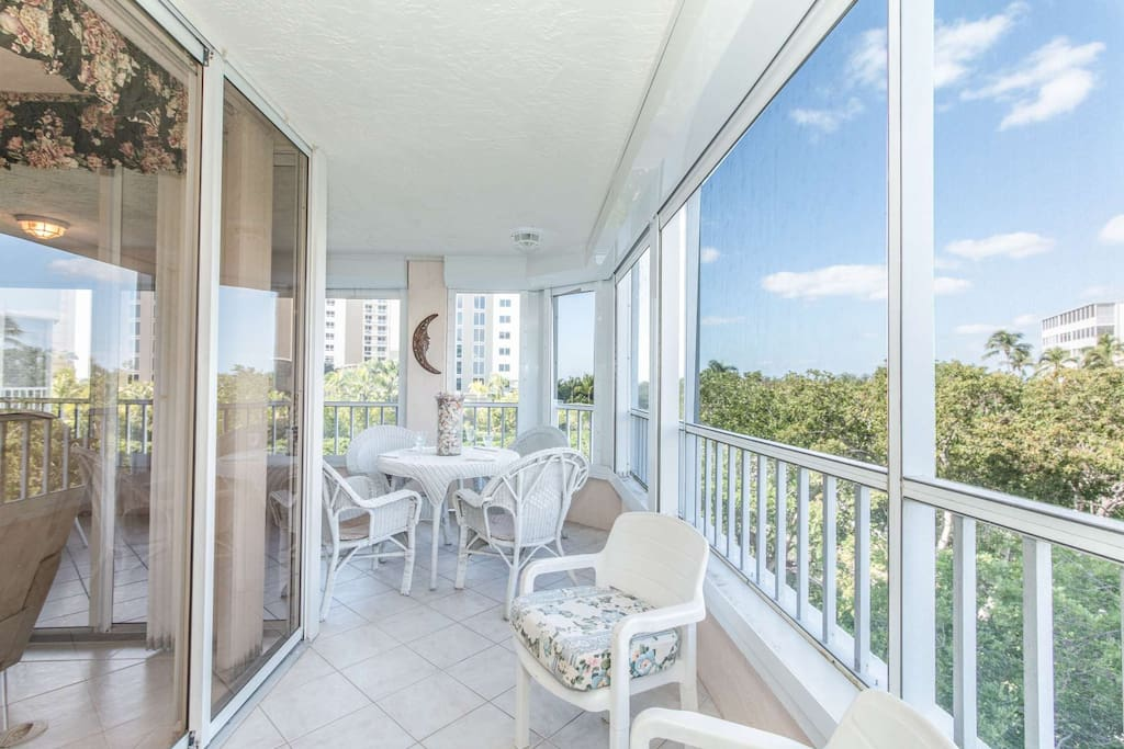 Huge wrap around lanai accessible from LR/DR of this gated/secure 3rd floor Gulf Shore Dr. condo w/elevator, covered pkg. & private beach access.