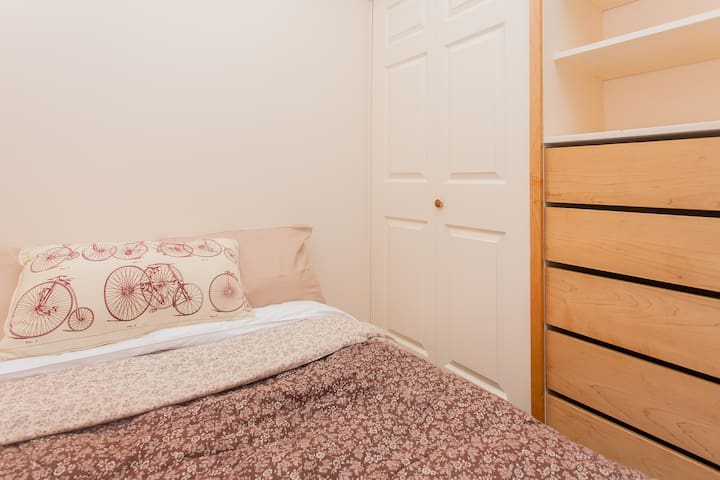 Full bed with closet and storage