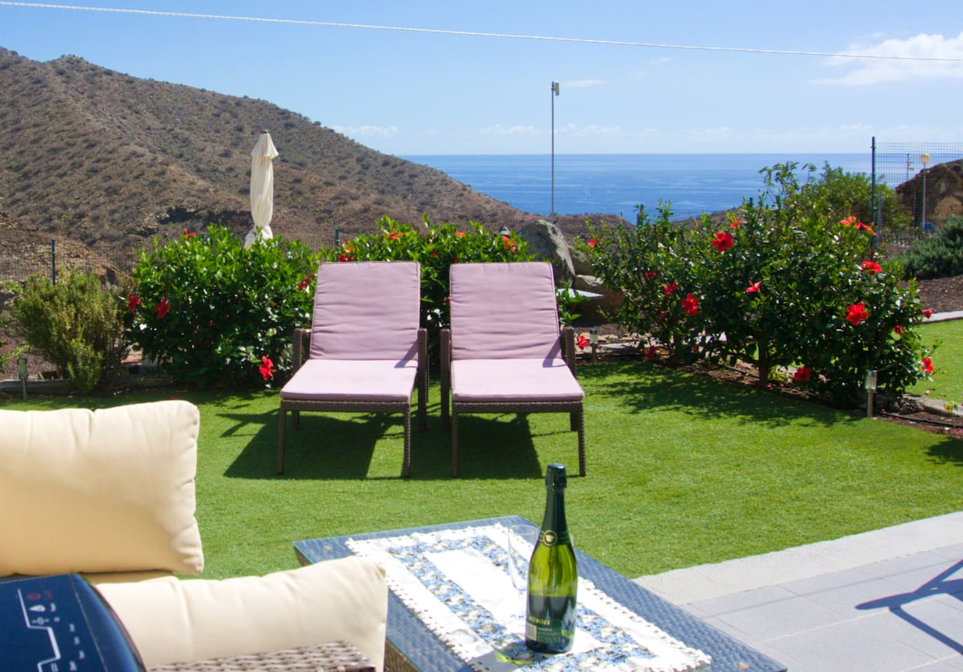 Mountain & ocean view apartment with large, sunny terrace and a private garden.