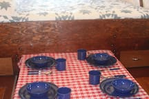 The table will push in for maximum space and pull out for meals and other activities.