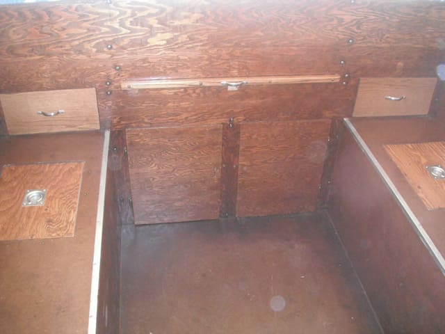 Insulated cold boxes on both sides to keep food stored and chilled, also lots of storage space under the bed.