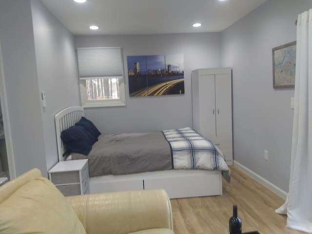 Sleeping area with queen bed
