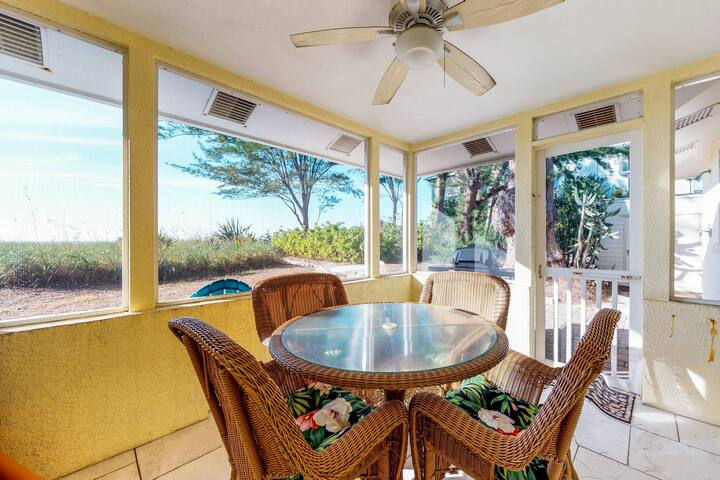 Quaint beachfront duplex in ideal location - screened lanai & free trolley!