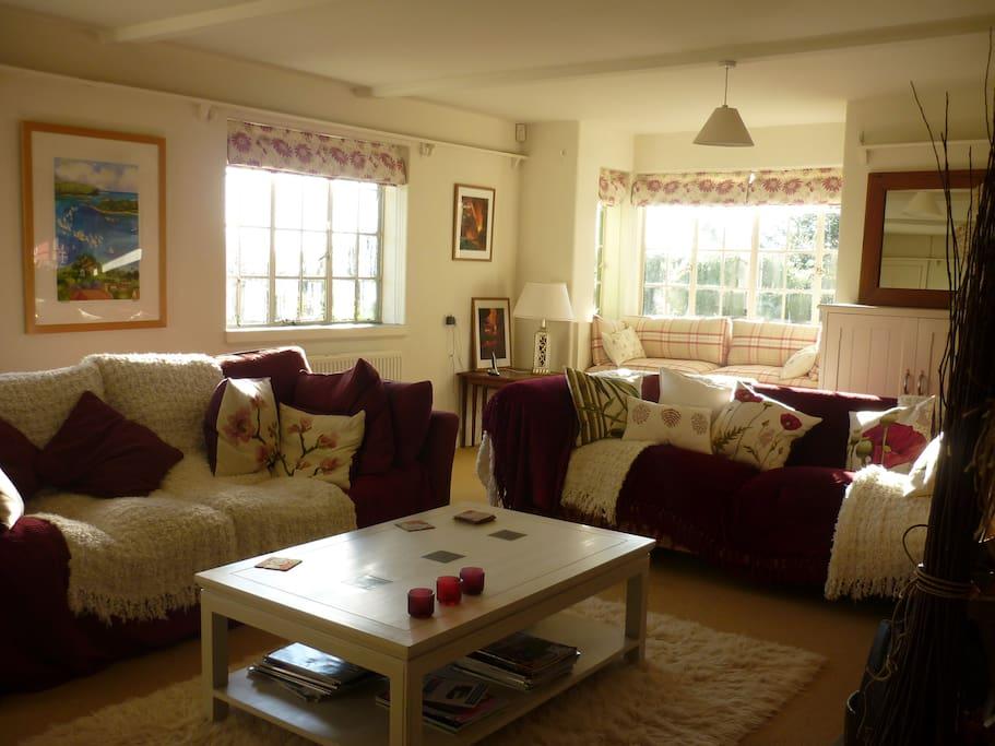 Main living room with window seat plus super flumpy sofas!