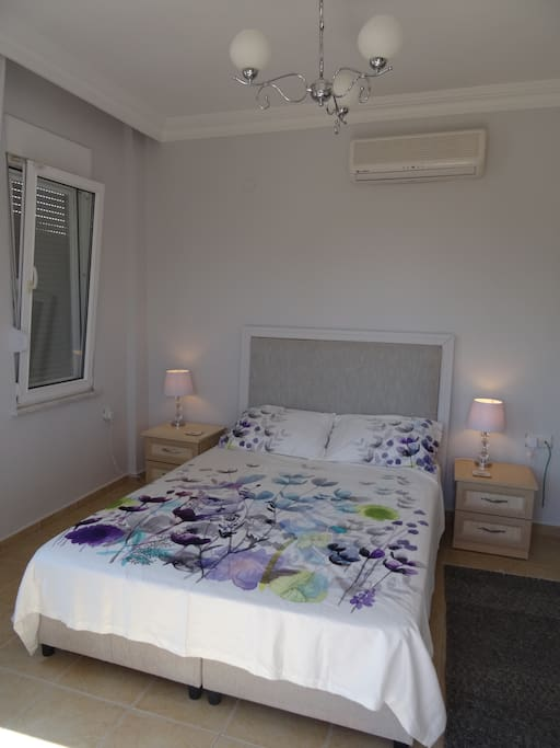 Master bedroom, air con, balcony, wardrobes.