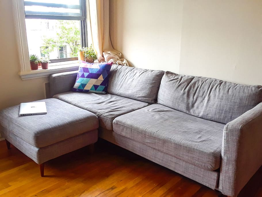 """Comfy sofa which can sleep somebody up to 6'8"""" tall [and 3' wide]!"""