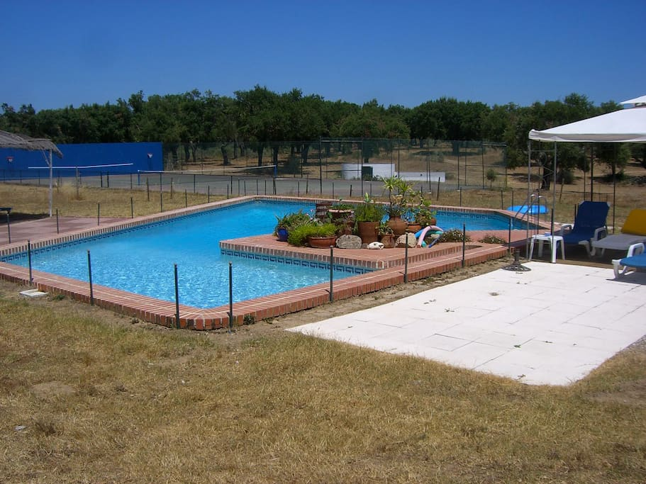 Swimming pool with tennis court on the back
