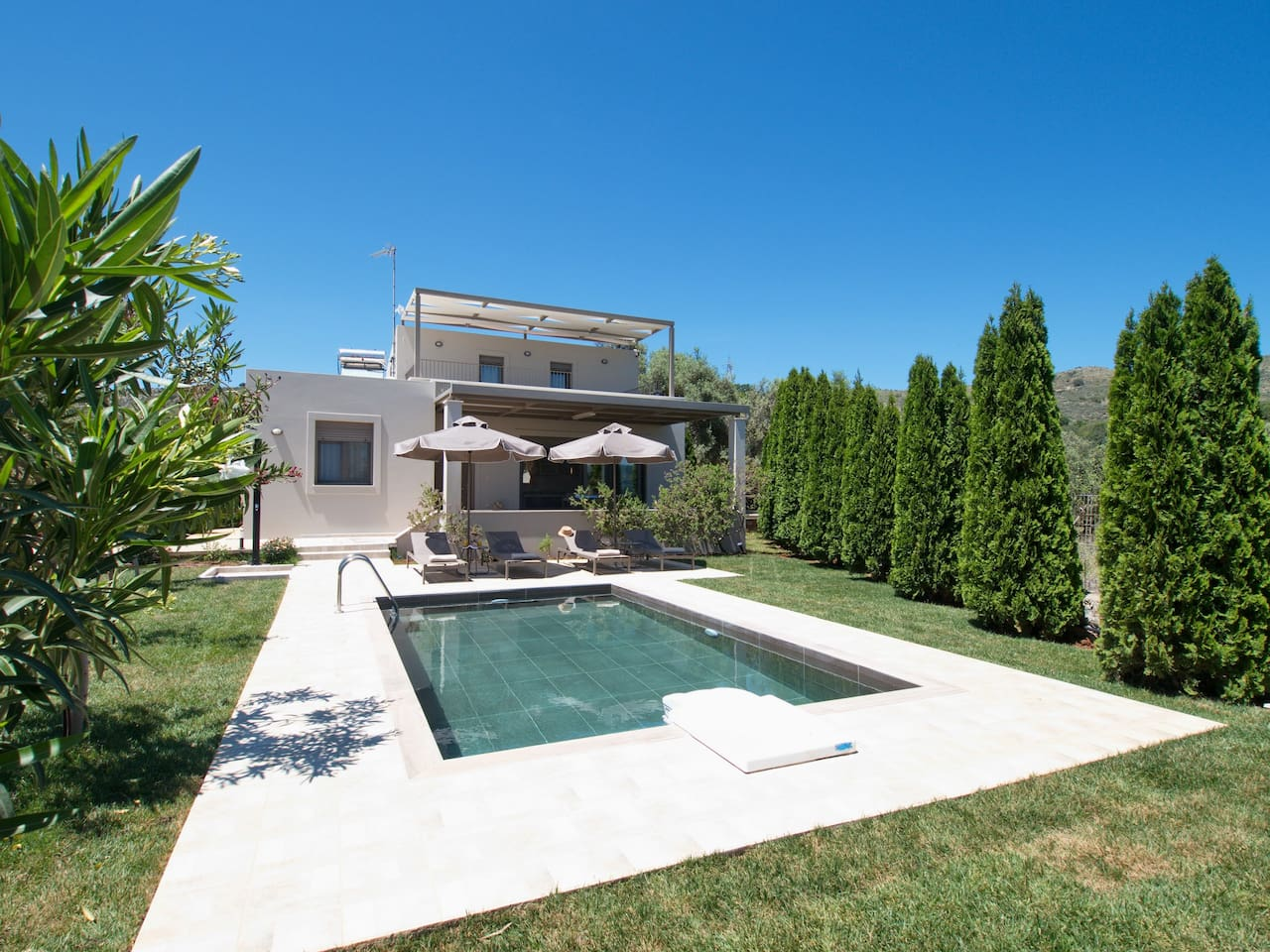 Private villa with pool and garden.