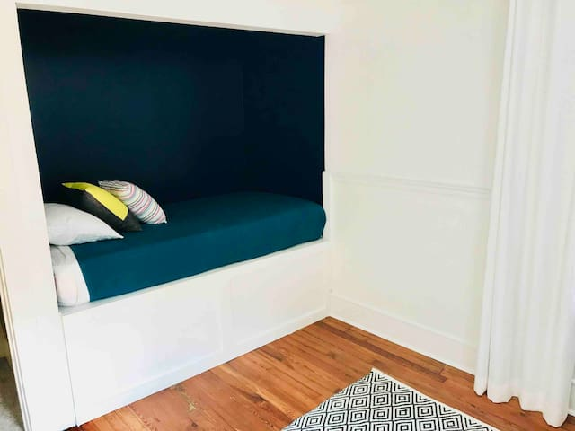 Our single bed has turned into a fan favorite - get cozy in that nook!