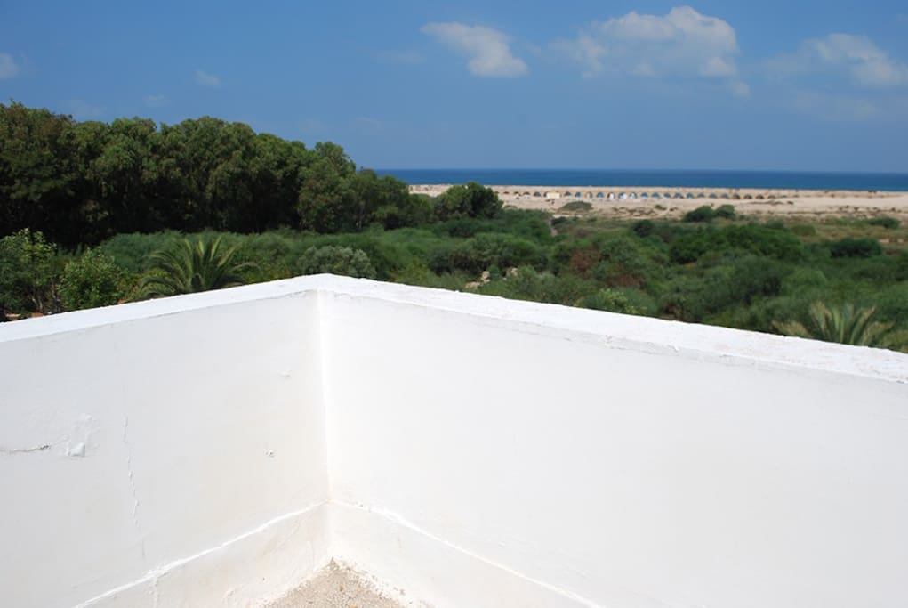 Private balcony from room on the roof and view to the sea and Aqueduct