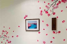 """Cherry blossom room"" decor! Room features dimmable Phillips Hue lights with remote control to easily turn off lights from the bed!"