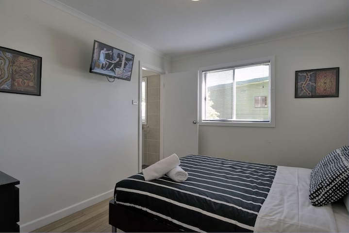 The main bedroom has an ensuite bathroom and second TV