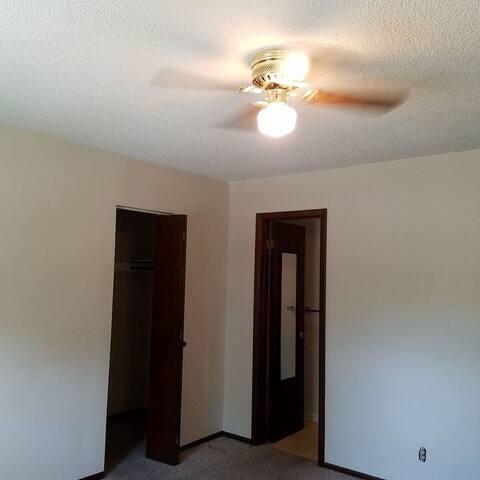 Walk up a few stairs to 2 bedrooms