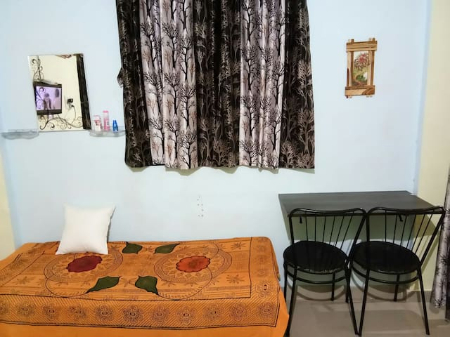 Studio Apartment with Air conditioner at center.