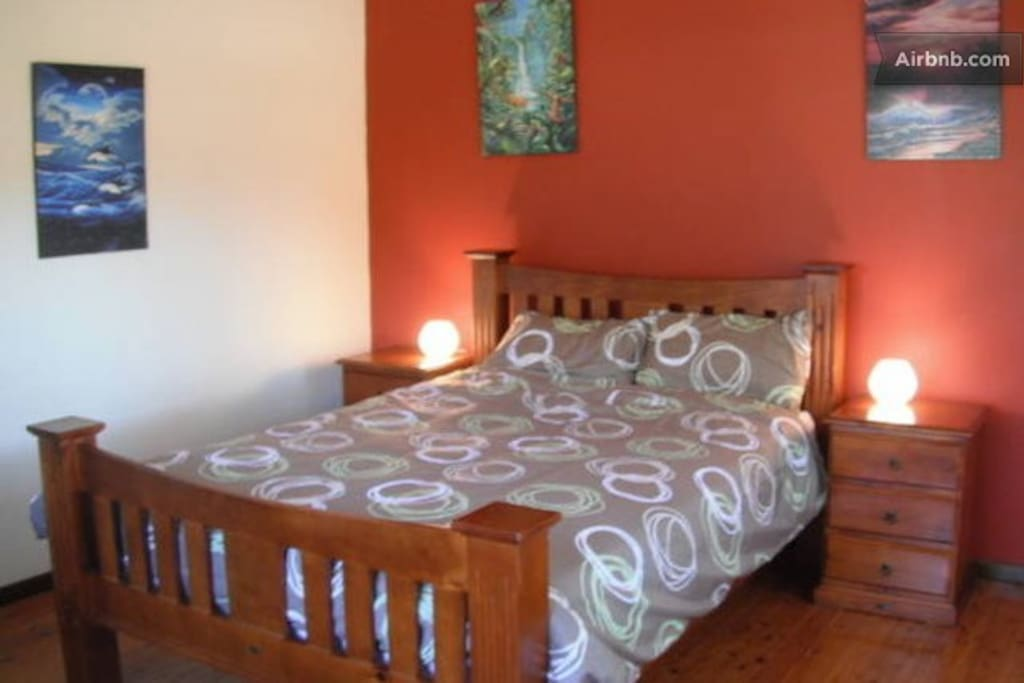 Queen bed upstairs with small flat screen digital TV