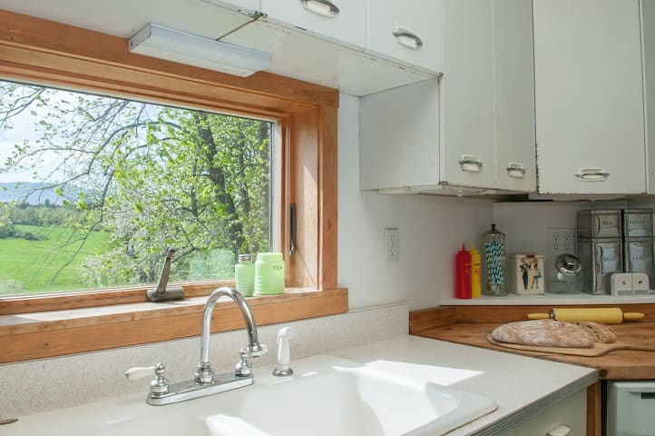 Bright and airy kitchen with all of the amenities, plus a beautiful view.