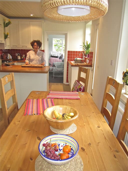 Kitchen and dining room with back utility room with washer, dryer  and ironing areal