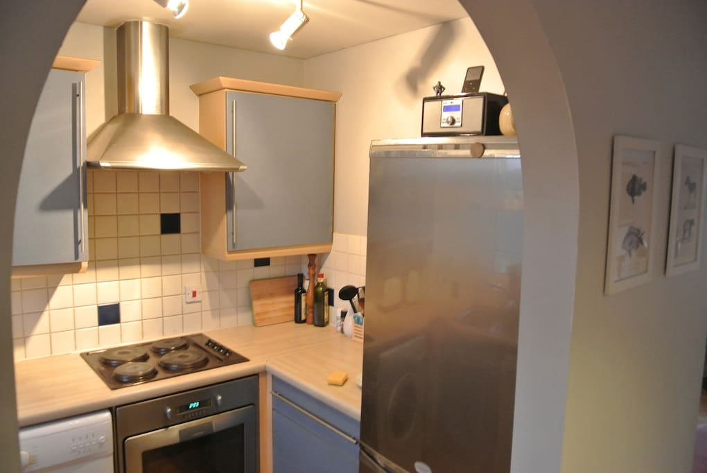 Kitchen, with electric oven, hob and fridge-freezer