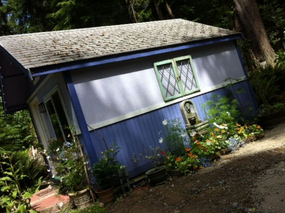 Tucked in the woods, with a sweet garden to enjoy...