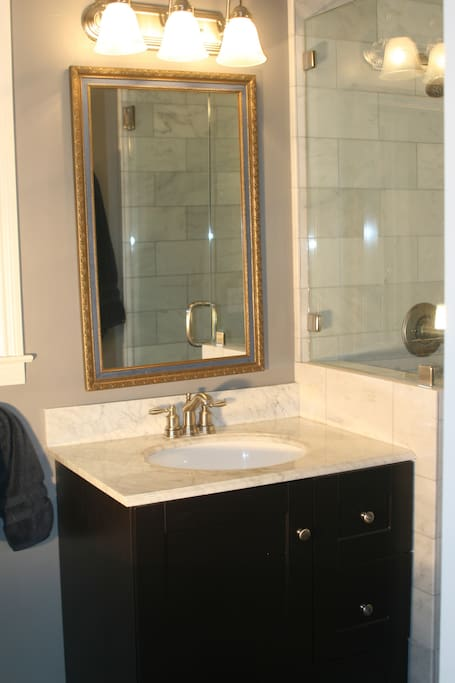 Bathroom - all Carrera marble surfaces.