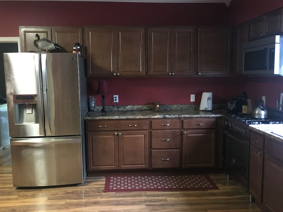 Stainless appliances, Dishwasher, microwave, gas range, and refrigerator. Kitchen utensils available.