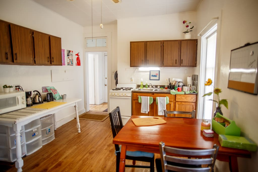 The kitchen includes a dining room table, appliances and snacks.