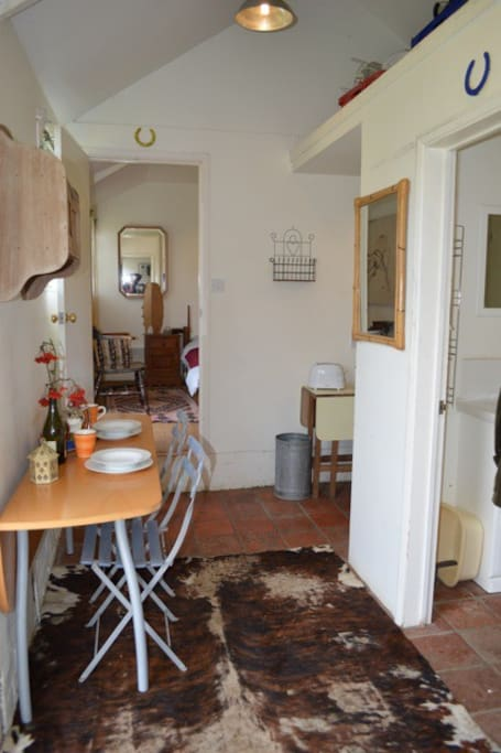 Kitchen then sitting room from bedroom door