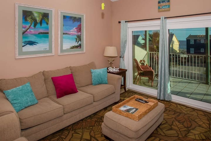 """Living room w/sofa, side chair, coffee and end table, 46"""" TV/DVD, ceiling fan and access to private balcony w/Gulf view"""