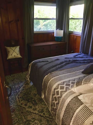 Bedroom 1 with queen bed. Plenty of dresser storage and closet