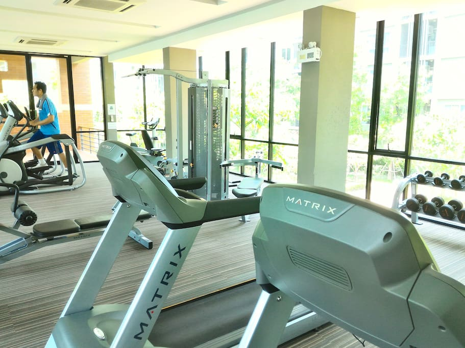 Gym with full of equipment.