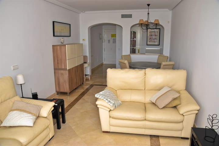 Spacious living/dining room, dining table & four matching chairs, 2 double sofas, flatscreen TV & DVD player. Full width glass door access to terrace.