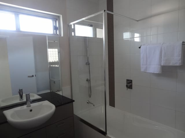 Shared guest bathroom / laundry