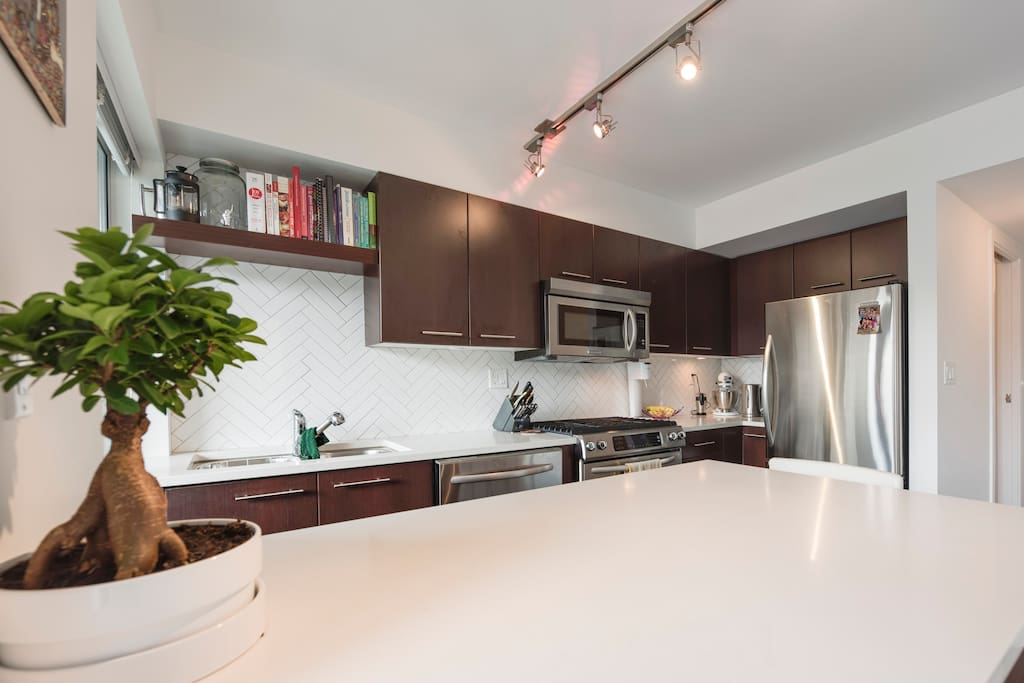 Bright, sunny kitchen is a pleasure to prepare meals in. Features dishwasher, gas stove, microwave and large refrigerator.