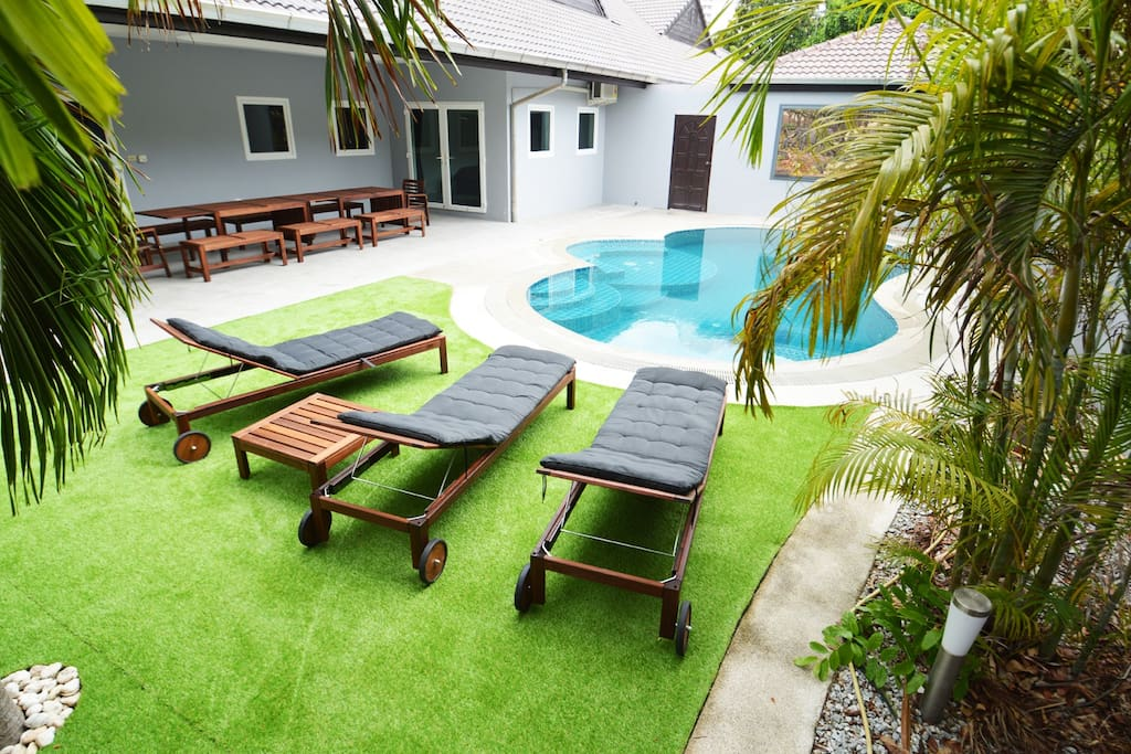 The pool area with sunbeds
