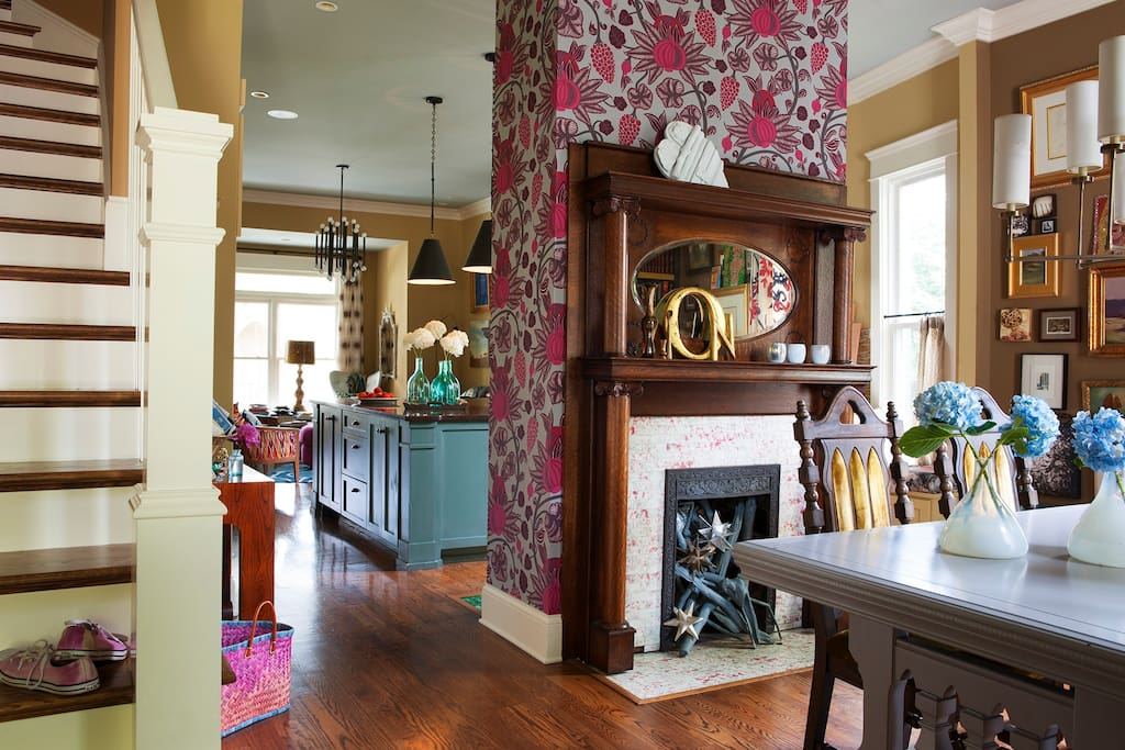Eclectic layered decorating style embraces you as you walk in the home. Open floor plan with 11ft ceiling a large kitchen island and living room towards the back of the house.
