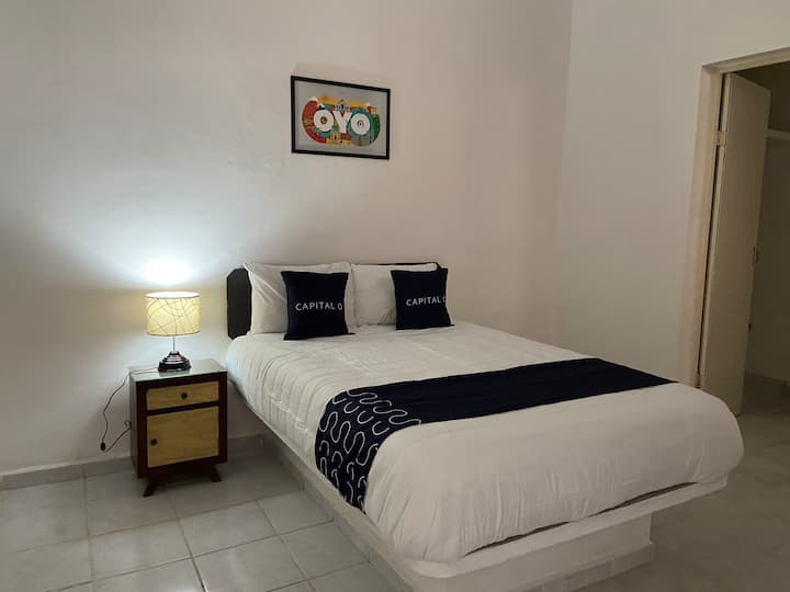 Habitación privada en hostal.  Capital O