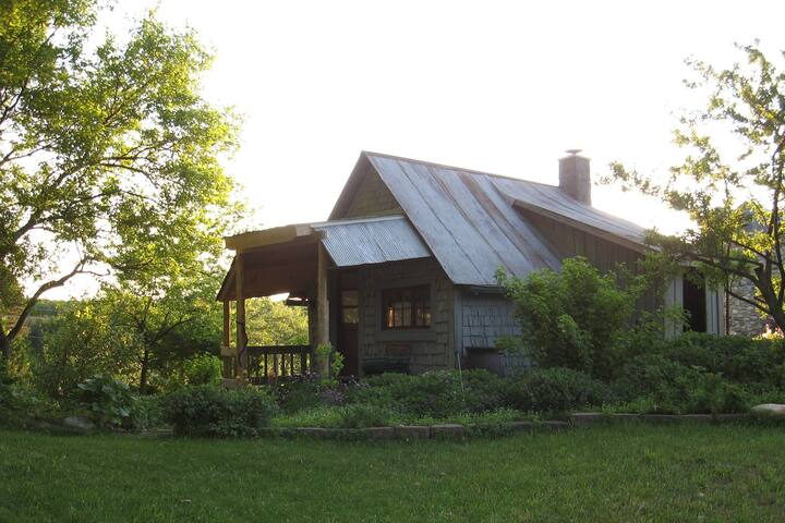 120 year old cedarshake cabin on 20-acre homestead