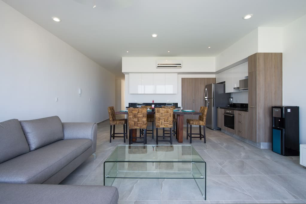 Living area, dining room and kitchen